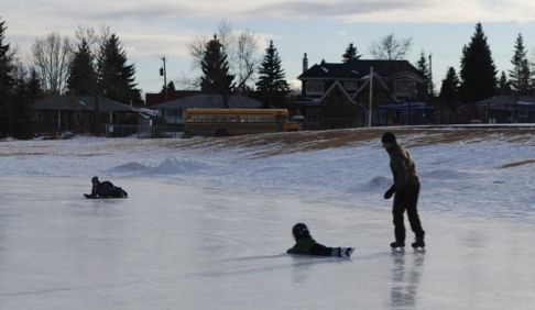 Skating and sliding on the Wildwood Community Outdoor Rink (Photo: Heather Albers)