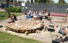 Families creating wood sculptures and bug hotels at the Water Spiral Community Workshop (photo: Michelena Bamford)